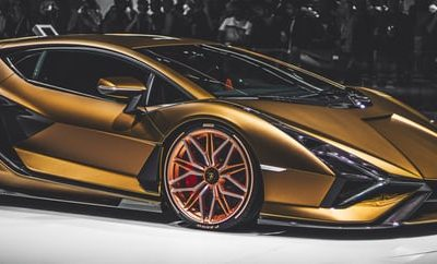 What are the benefits of going to a luxury car show?